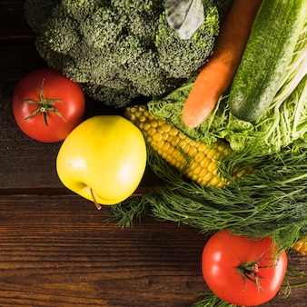Overhead view of fresh raw vegetables on wooden desk