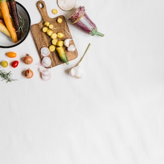 An overhead view of fresh vegetables on white background