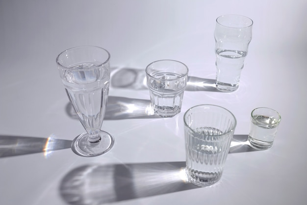 An overhead view of glasses with dark shadow on white background