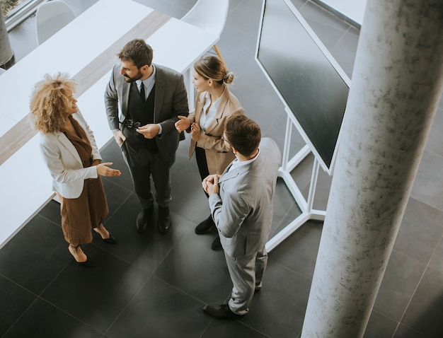 Overhead view at group of multiethnic business people working together in the office