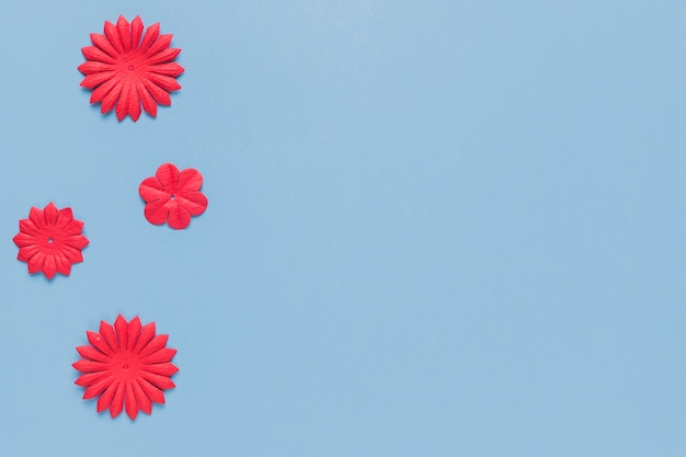 Overhead view of handmade red paper flower cutout for craft