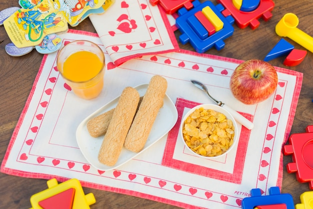 Overhead view of healthy breakfast on placemat over the wooden table