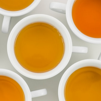 An overhead view of herbal tea in white cup