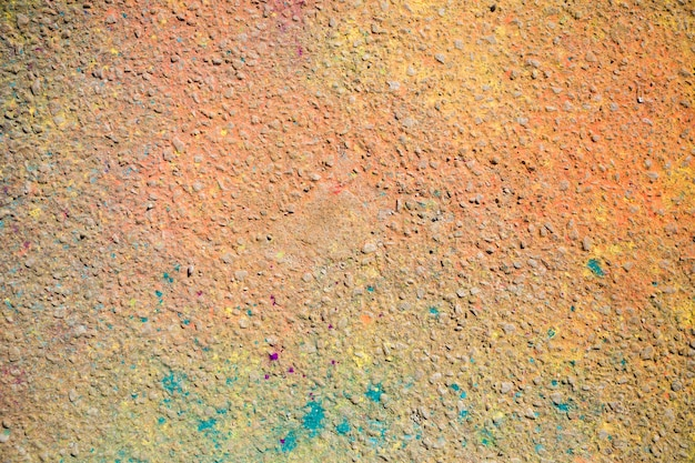 An overhead view of holi color on ground