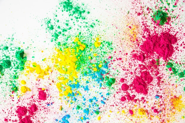 An overhead view of holi powder on white background