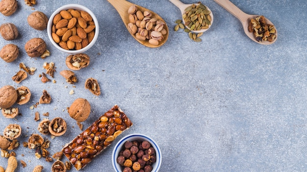 An overhead view of ingredients for making energy bar on concrete background