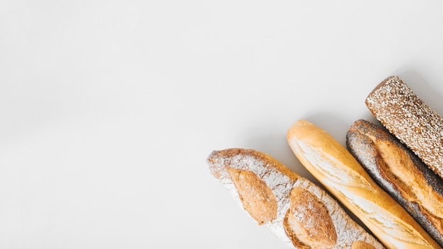 An overhead view of long baguettes isolated on white background