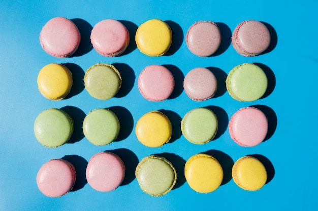 An overhead view of macaroons on blue background