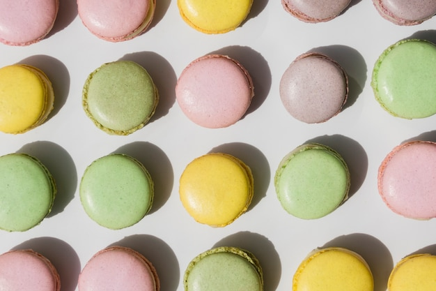 An overhead view of macaroons on white backdrop