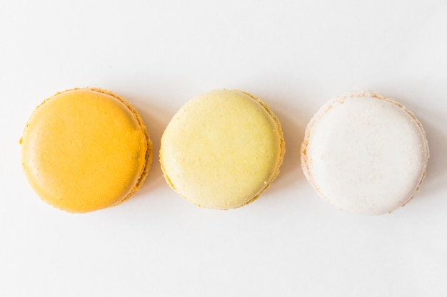 An overhead view of macaroons on white background
