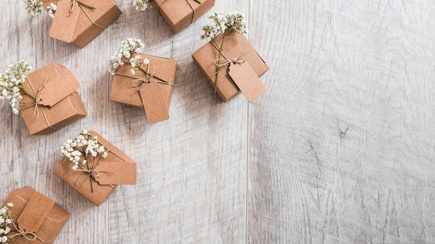 An overhead view of many gift cardboard boxes on wooden textured backdrop