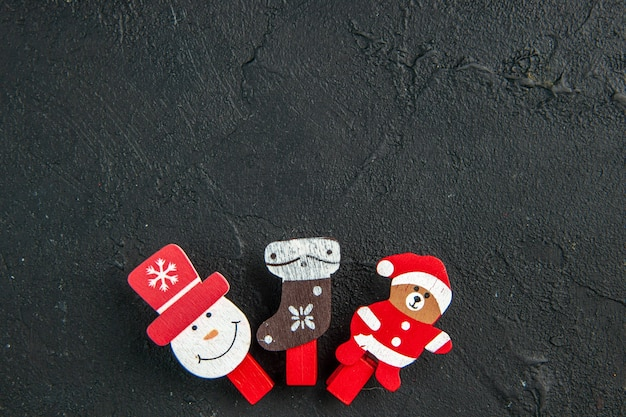 Overhead view of new year decoration accessories lined in a row on black surface