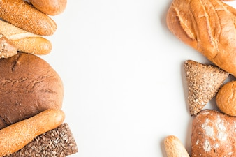 Overhead view of baked bread loves on white background