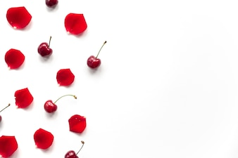 Overhead view of cherry and rose petals over white background