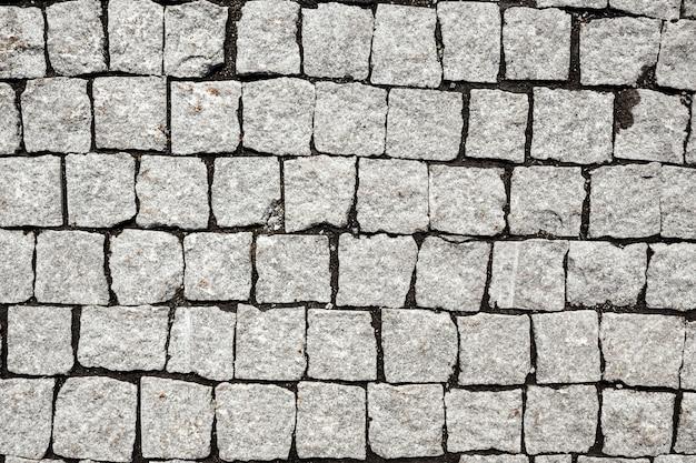 조약돌 거리 질감의 오버 헤드 보기입니다. 돌 포장 텍스처입니다. 고품질 사진