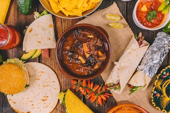Overhead view of delicious mexican food on brown wooden table