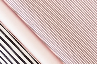 Overhead view of folded black and pink stripes fabric