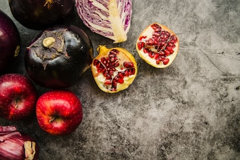 Overhead view of fresh fruits and vegetable on concrete background