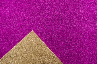 Overhead view of golden carpet on purple background