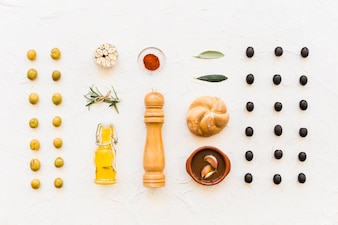 Overhead view of ingredients with row of black and green olives