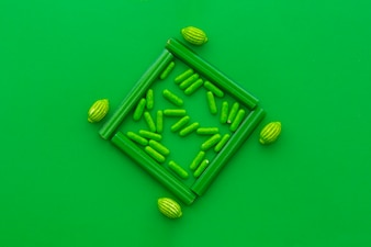Overhead view of vivid candies on green backdrop