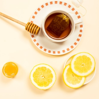 Overhead view of organic tea with lemon slice and honey