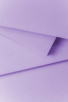 An overhead view of purple paper textured background