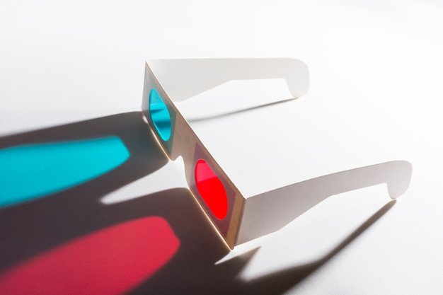 An overhead view of red and blue 3d glasses on reflective background
