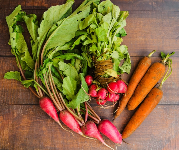 Overhead view of a root vegetables on wooden background