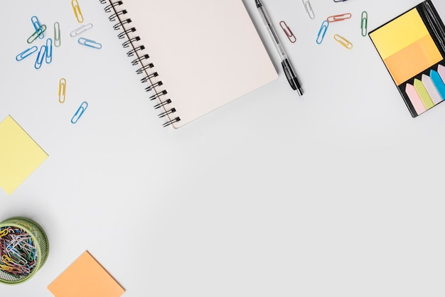An overhead view of stationeries on white background