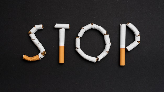 Overhead view of stop text made from cigarettes
