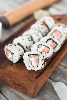 An overhead view of sushi on wooden tray