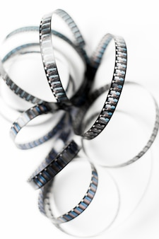 An overhead view of tangled film stripes isolated on white backdrop