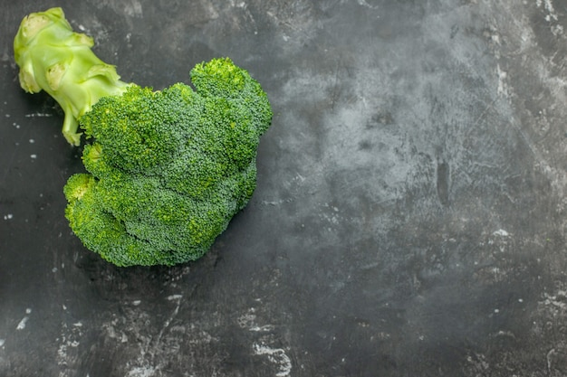 Overhead view of tasty and healthy fresh broccoli on gray table