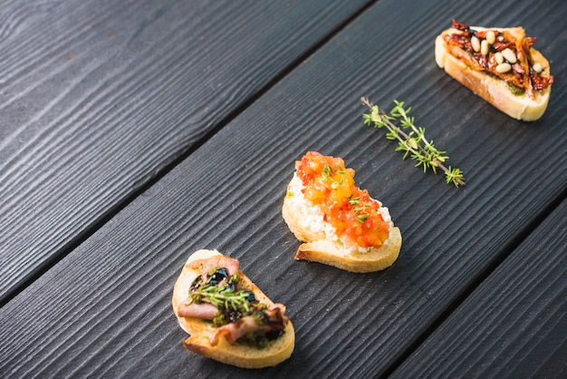 An overhead view of toast appetizer on wooden backdrop