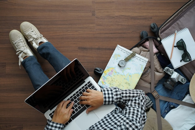 Overhead view of traveler woman plan with working laptop computer