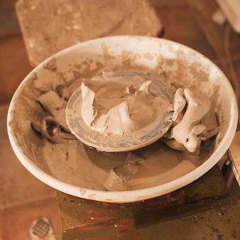 An overhead view of used wet clay on pottery wheel's