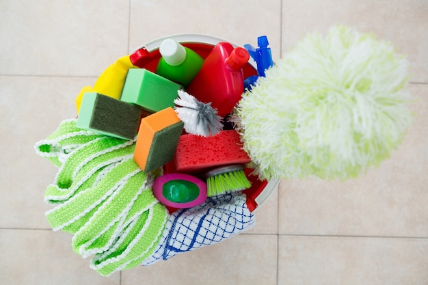 Overhead view of various cleaning products in bucket