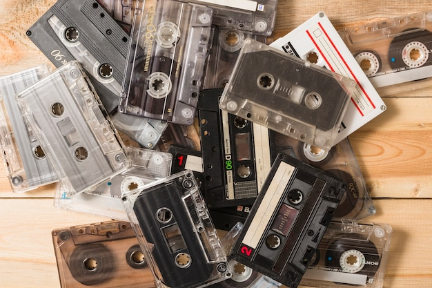 Overhead view of vintage cassette tapes on wooden background