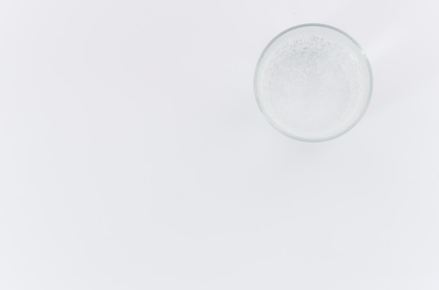 An overhead view of water glass on white background with space for writing the text