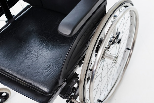 An overhead view of a wheelchair on white backdrop