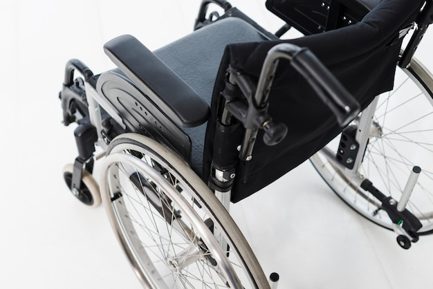 An overhead view of wheelchair on white floor
