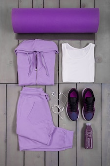 Overhead view woman's workout outfit. female sports equipment.