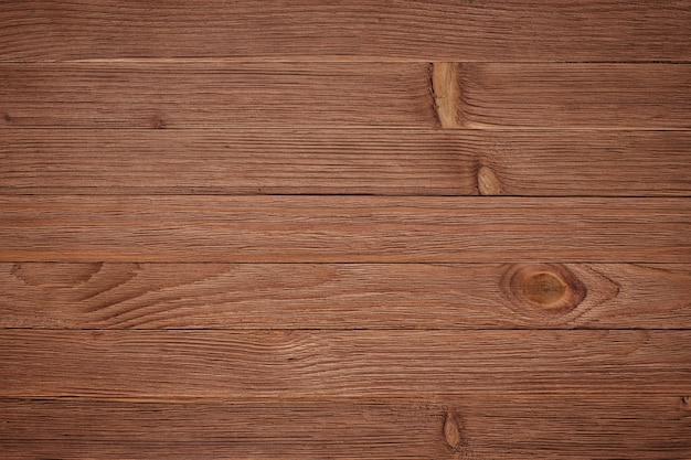 Overhead view of wooden table, wall texture