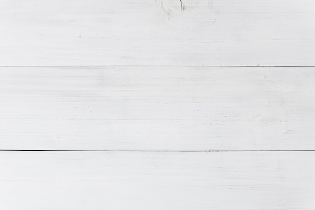 An overhead view of wooden white plank background
