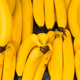 An overhead view of yellow bananas
