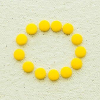 Overhead view of yellow candies forming circular frame