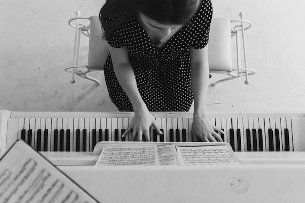An overhead view of a young woman playing the piano
