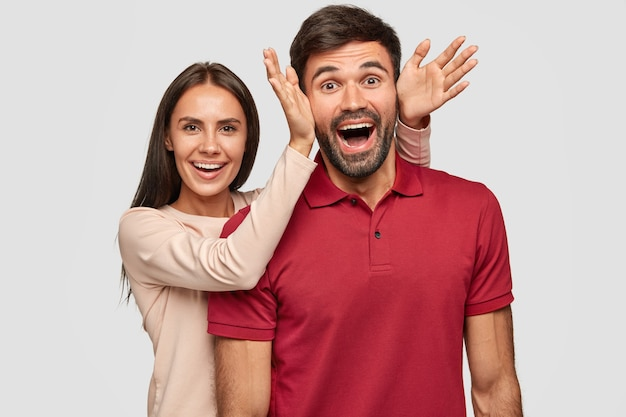 Overjoyed funny girlfriend and boyfriend foolish together, have happy expressions
