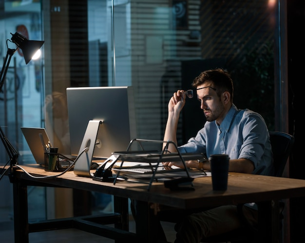 Overloaded man working late in office
